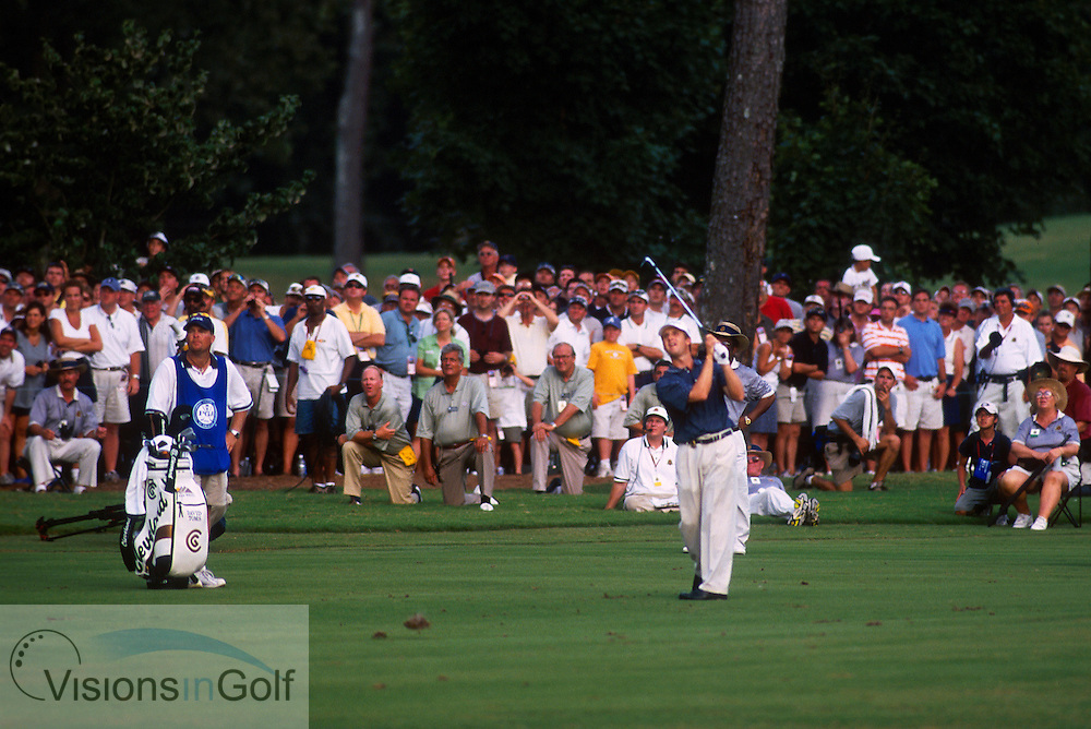 David Toms hits wedge to #18 green after layup.  He parred the hole to win.<br />