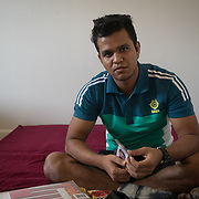 PALM SPRINGS, FLORIDA, JANUARY 14, 2018<br /> Mamudul Hasson, 21, in the bedroom where he sleeps next to  his uncle in his house. Hassan is a Rohingya Muslim refugee who just arrived to the United States three weeks ago.<br /> (Photo by Angel Valentin/Freelance)