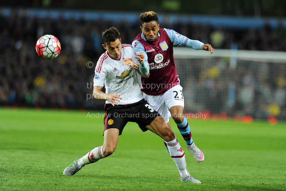 Jordan Amavi of Aston Villa &reg; challenges Matteo Darmian of Manchester Utd. Barclays Premier League match, Aston Villa v Manchester Utd at Villa Park in Birmingham, Midlands on Friday 14th August  2015.<br /> pic by Andrew Orchard, Andrew Orchard sports photography.