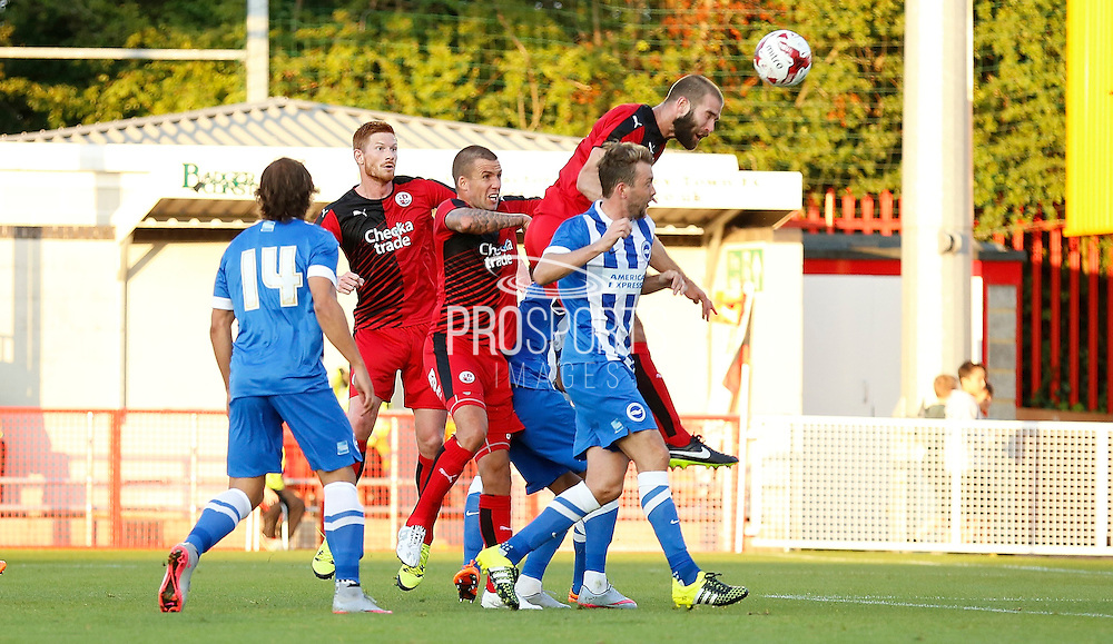 Joe McNerney leaping highest to win the header during the Pre-Season Friendly match between Crawley Town and Brighton and Hove Albion at the Checkatrade.com Stadium, Crawley, England on 22 July 2015. Photo by Michael Hulf.