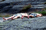 Two men, ying down sunbathing, Kristiansands Norway 2000