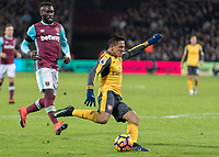 Football - 2016 / 2017 Premier League - West Ham United vs. Arsenal <br /> <br /> Alexis Sanchez of Arsenal strikes home Arsenals second goal at The London Stadium.<br /> <br /> COLORSPORT/DANIEL BEARHAM
