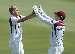 Olly Stone of Northamptonshire celebrates with Adam Rossington of Northamptonshire after Ian Cockbain of Gloucestershire is caught by Alex Wakely bowled by Stone - Photo mandatory by-line: Dougie Allward/JMP - Mobile: 07966 386802 - 09/07/2015 - SPORT - Cricket - Cheltenham - Cheltenham College - LV=County Championship 2