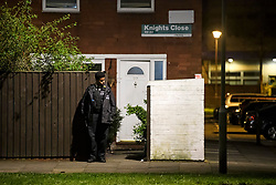 © Licensed to London News Pictures. 20/03/2019. London, UK. A police officer guard the entrance to a property at on Knights Close Hackney, east London where a A 28-year-old man was shot by armed police after reportedly making threats to kill while armed with knives. Photo credit: Ben Cawthra/LNP
