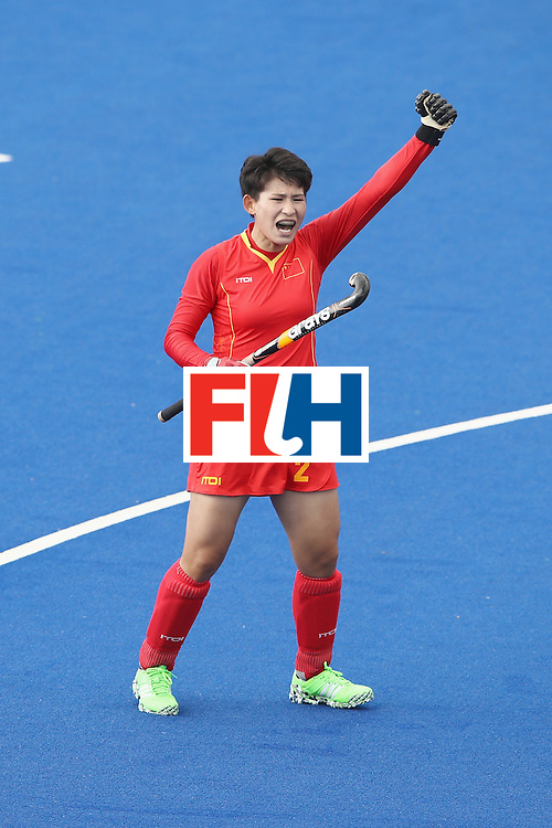 RIO DE JANEIRO, BRAZIL - AUGUST 07:  Mengyu Wang of China celebrtaes a goal scored by Yang Peng scored a goal during the women's pool A match between China and Germany on Day 2 of the Rio 2016 Olympic Games at the Olympic Hockey Centre on August 7, 2016 in Rio de Janeiro, Brazil.  (Photo by Mark Kolbe/Getty Images)
