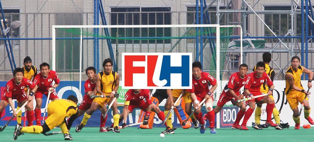 Kakamigahara (Japan): Japanese defending a free hit taken outside the penalty circle by Malaysians in the Olympic Hockey Qualifier at Gifu Perfectural Green Stadium at Kakamigahara on 12 April 2008. <br /> Japan drew with Malaysia 3-3. <br /> Photo: GNN/ Vino John
