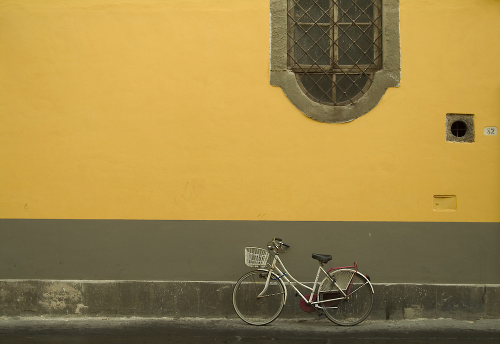 Bike leaning against the wall of a building in Lucca, Italy.
