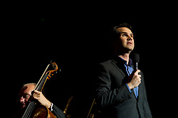 © Copyright licensed to London News Pictures. 18/10/2010. Jimmy Carr, comedian, onstage at the Royal Albert Hall. Musicians and composers from the world of film gather for Concert for Care, Royal Albert Hall, London.