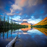 reflecting sunrise sinopha mountain, glacier national park, pray lake