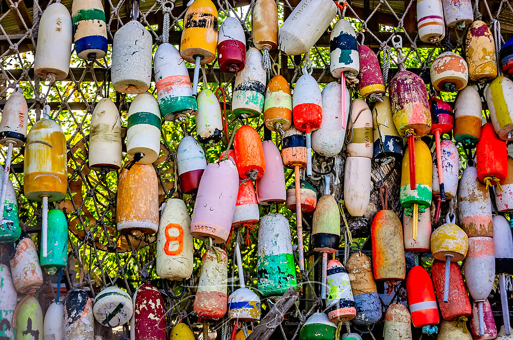 Colorful styrofoam buoys at The Tin Shed in Apalachicola Florida ...