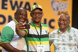 Pule Mabe takes a selfie with ANC presidential hopeful Cyril Ramaphosa and outgoing ANC President Jacob Zuma before results are announced at the 54th National Elective Conference at Nasrec, Johannesburg on 18 December 2017. The conference will see a new leader of the ANC elected, with hopefuls Cyril Ramaphosa and Nkosazana Dlamini-Zuma being the primary contenders. Picture: David Naiker (Credit Image: © Dave Naicker/Xinhua via ZUMA Wire)