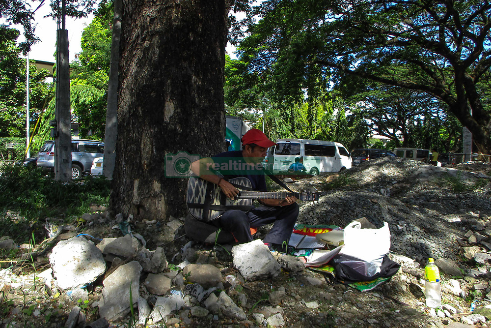 May 10, 2017 - Philippines - Amado Malugao plays his guitar in Quezon City, east of Manila, Philippines on Wednesday, May 10, 2017. Malugao, a musician and a painter who became homeless, aspires to become a top performer someday, opting to sing English pop songs in the belief that it will help him rise to fame. (Credit Image: © Richard James Mendoza/Pacific Press via ZUMA Wire)