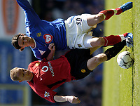 Photo. Richard Lane, Digitalsport..<br /> Portsmouth v Manchester United. FA Barclaycard Premiership. 17/04/2004.<br /> Nicky Butt and Alexie Smertin battle for the ball.