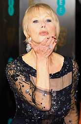Helen Miirren blows a kiss as she arrives at the BAFTA Film Awards. London, United Kingdom. Sunday, 16th February 2014. Picture by Max Nash / i-Images