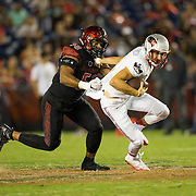 08 October 2016: The San Diego State Aztecs football team open's up the mountain west conference season at home against the University of Nevada Las Vegas Rebels.  San Diego State defensive linemen Alex Barrett (58) seen here sacking UNLV quarterback Dalton Sneed (18) in the fourth quarter. The Aztecs beat the Rebels 26-7 to improve to 4-1 and 1-0 in conference play. www.sdsuaztecphotos.com