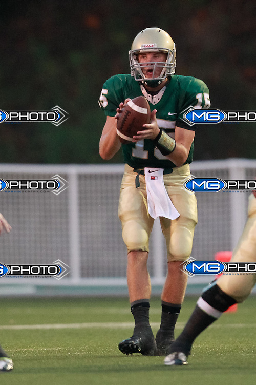 Sep 6, 2013; Mountain Brook, AL, USA;  Mountain Brook's Jacob Carroll (15) takes the snap of the ball against Shades Valley. Mandatory Credit: Marvin Gentry