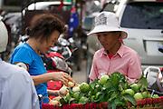 Phnom Penh, Cambodia. Vegetable vendor.