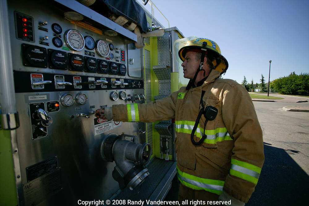 © 2008 Randy Vanderveen, all rights reserved.Grande Prairie, Alberta.Firefighter Ward Redwood mans the pump as Grande Prairie firefighters train in Muskoseepi Park by conducting some Performance Standard Drills during the mid-day hours of a summer day.