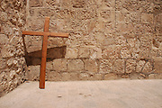 Israel, Jerusalem Old City, pilgrims procession, Good Friday at the Via Dolorosa,  Easter 2006, A cross leaning on a wall