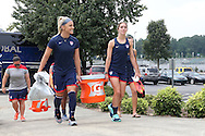 18 August 2014: Julie Johnston (left) and Morgan Brian (right) carry a cooler onto the field. The United States Women's National Team held a training session on Field 4 at WakeMed Soccer Park in Cary, North Carolina.
