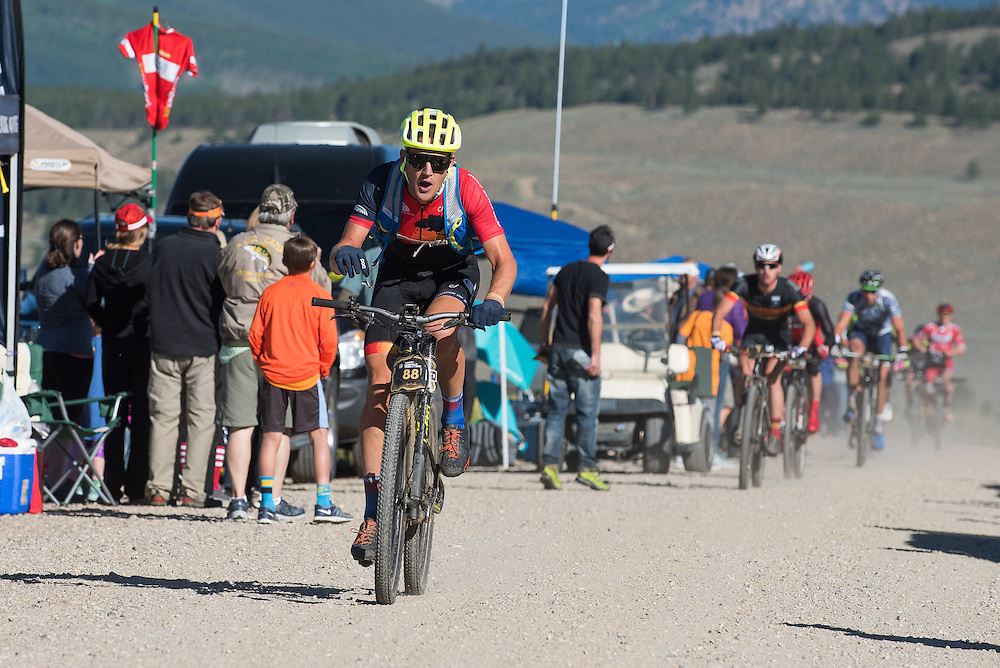 Former road star Ted King leads a chase group through the feedzone before the climb up Columbine.