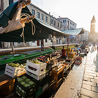 Early morning at the floating produce market on the Rio De St. Barnaba canal, Venice, Itally