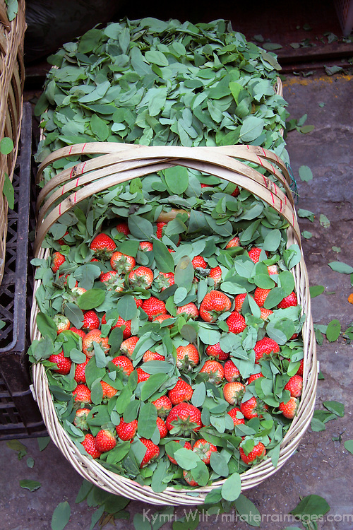 Asia, China, Chongqing. Strawberries for sale in local street market in the city of Chongqing.