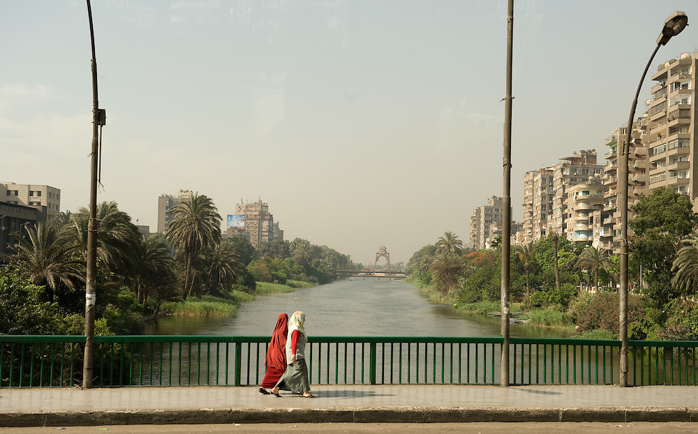 Two Egyptian women cross the Manyal Bridge over the Nile river in Cairo Egypt on 04 June 2009.