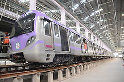 April 25, 2018 - Kolkata, West Bengal, India - Indian Kolkata Metro Rail Corporation (KMRC) workers stand alongside new East-West Metro carriages during a preview for the new trains at a workshop in Eastern India city Kolkata on April 25, 2018. - Officials have announced trial runs of the new East-West Metro carriages may start in May First week , with a commercial run starting around October 2018. (Credit Image: © Debajyoti Chakraborty/NurPhoto via ZUMA Press)