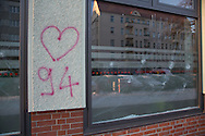 """Berlin, Germany - 19.01.2016 <br /> <br /> About 4 o'clock in the morning noticed a house technician damages on the Social Democratic Party of Germany office of Ralf Wieland in Berlin-Gesundbrunnen. 5 windows were damaged by stone throws. In addition, slogans were left with Rigaer94 reference. As well as the slogan """"#tomduarsch"""" who apparently directed against the Berlin SPD politician Tom Schreiber. It is the fourth attack on the office within six months.<br /> <br /> Gegen 4 Uhr morgens bemerkte ein Haustechniker die Schaeden am SPD-Buergerbuero von Ralf Wieland in Berlin-Gesundbrunnen. 5 Scheiben wurden durch Steinwuerfe beschaedigt. Außerdem wurden die Schriftzuege mit Rigaer94-Bezug hinterlassen. Sowie der Schriftzug """"#tomduarsch"""", der sich offenbar gegen den Berliner SPD-Politiker Tom Schreiber richtet. Es ist die vierte Attacke auf das Buero innerhalb von sechs Monaten.<br /> <br /> Photo: Bjoern Kietzmann"""