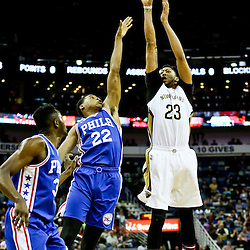 Feb 19, 2016; New Orleans, LA, USA; New Orleans Pelicans forward Anthony Davis (23) shoots over Philadelphia 76ers forward Richaun Holmes (22) during the first quarter of a game at the Smoothie King Center. Mandatory Credit: Derick E. Hingle-USA TODAY Sports