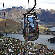 Mountain bike racers take the Skyline Gondola to  tackle the Ben Lomond Forest course high above Queenstown during practice for the Corona Dirtmasters Downhill event in Queenstown, Central Otago, which takes place on Sunday. The technically demanding course will start at the Gondola and finish in Brecon Street. The event was part of the inaugural Queenstown Bike Festival, taking place from 16th-25th April. The event hopes to highlight Queenstown's growing profile as one of the three leading biking centres in the world. Queenstown, Central Otago, New Zealand. 22nd April 2011. Photo Tim Clayton..