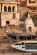 Upturned boats on the banks for the river ganges at Varanasi, Uttar Pradesh, India