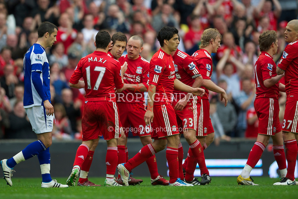 LIVERPOOL, ENGLAND - Saturday, April 23, 2011: Liverpool's Joe Cole celebrates scoring his side's fifth goal against Birmingham City with team-mate during the Premiership match at Anfield. (Photo by David Rawcliffe/Propaganda)