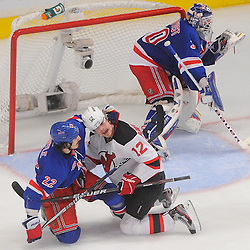 May 14, 2012: New York Rangers center Brian Boyle (22) and New Jersey Devils left wing Alexei Ponikarovsky (12) tussle during third period action in game 1 of the NHL Eastern Conference Finals between the New Jersey Devils and New York Rangers at Madison Square Garden in New York, N.Y. The Rangers defeated the Devils 3-0.