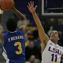 Jan 04, 2010; Baton Rouge, LA, USA;  McNeese State Cowboys forward Patrick Richard (3) shoots over LSU Tigers forward Bo Spencer (11) during the second half at the Pete Maravich Assembly Center. LSU defeated McNeese State 83-60.  Mandatory Credit: Derick E. Hingle-US PRESSWIRE
