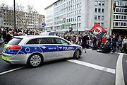 Frankfurt am Main   11 Apr 2015<br /> <br /> Am Samstag (11.04.2015) demonstrierten etwa 35 Personen der Gruppe &quot;Freie B&uuml;rger f&uuml;r Deutschland&quot; (FBfD, ex PEGIDA) auf dem Rossmarkt in Frankfurt am Main gegen &quot;Islamisierung&quot;, ihre Redebeitr&auml;ge gingen in dem Geschrei der etwa 800 Gegendemonstranten unter.<br /> Hier: Gegendemonstranten haben eine Strasse blockiert, die Fahne &quot;Antifaschistische Aktion&quot; wird geschwenkt.<br /> <br /> &copy;peter-juelich.com<br /> <br /> [Foto honorarpflichtig   No Model Release   No Property Release]