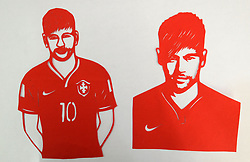 June 12, 2018 - Handan, Handan, China - Handan, CHINA-12th June 2018: The folk artist Feng Shiping makes paper-cutting works of football stars including Lionel Messi, Neymar da Silva Santos Júnior, Thomas Müller, Luis Suárez and Cristiano Ronaldo in Handan, north China's Hebei Province, marking the upcoming World Cup 2018. (Credit Image: © SIPA Asia via ZUMA Wire)
