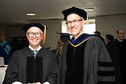 Honrary degree recipient Robert Kirshner (Left) poses for a photo Joe Shields at graduate commencement. Photo by Ben Siegel