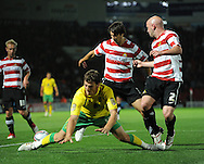 Doncaster - Tuesday September 14th, 2010:  Norwich City's Chris Martin is brought down, should this have been a penalty? during the NPower Championship match at Keepmoat Stadium, Doncaster. (Pic by Dave Howarth/Focus Images)