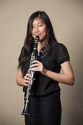 Amanda Le, MHS senior, poses for a portrait with her clarinet before performing in the Milpitas Unified School District's 11th Annual Music Festival at Milpitas High School in Milpitas, California, on April 10, 2014. (Stan Olszewski/SOSKIphoto)