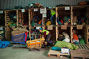 "Help Refugeess UK Volunteers sorting the donated tents at the warehouse in Calais which will then be gven to new arrival refugees at ""The Jungle"" refugee camp in Calais. Help Refugees has grown out of #helpcalais, a social media campaign started by Lliana Bird (Radio X DJ), Dawn O'Porter (Writer and Presenter), Josie Naughton and Heydon Prowse (The Revolution will be Televised) to raise a few funds and collect goods to take to Calais to help in some small way. The public response to the campaign was huge, and we were quickly able to provide aid in Calais and far beyond."