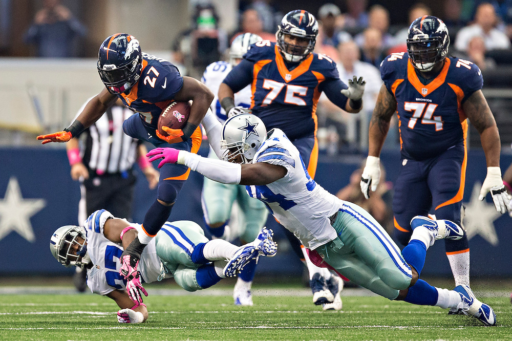 ARLINGTON, TX - OCTOBER 6:  Knowshon Moreno #27 of the Denver Broncos jumps over J.J. Wilcox #27 and is hit by DeMarcus Ware #94 of the Dallas Cowboys at AT&T Stadium on October 6, 2013 in Arlington, Texas.  The Broncos defeated the Cowboys 51-48.  (Photo by Wesley Hitt/Getty Images) *** Local Caption *** Knowshon Moreno; J.J. Wicox; DeMarcus Ware