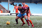Scunthorpe United forward Kyle Wootton (29) and Shrewsbury Town defender Matthew Sadler (5) battles for possession  during the EFL Sky Bet League 1 match between Scunthorpe United and Shrewsbury Town at Glanford Park, Scunthorpe, England on 17 March 2018. Picture by Mick Atkins.