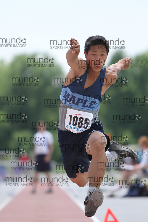 (London, Ontario}---05 June 2010) Danny Ly of Maple - Maple competing in the midget boys triple jump at the 2010 OFSAA Ontario High School Track and Field Championships in London, Ontario, June 05, 2010 . Photograph copyright Laura Barclay / Mundo Sport Images, 2010.