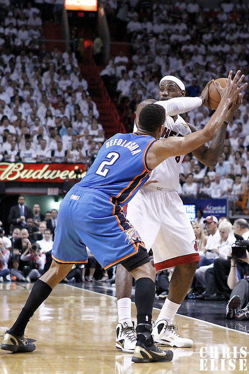 19 June 2012: Miami Heat small forward LeBron James (6) looks to pass the ball over Oklahoma City Thunder shooting guard Thabo Sefolosha (2) during the Miami Heat 104-98 victory over the Oklahoma City Thunder, in Game 4 of the 2012 NBA Finals, at the AmericanAirlinesArena, Miami, Florida, USA.
