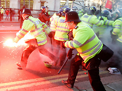 ©under license to London News Pictures. 09/12/2010 - The 4th wave of student protests in London. Students protest against  plans to raise student tuition fees.Police take control over smoke flare.   photo credit should be read as: Michael Zemanek / LNP