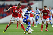 Nottingham Forest midfielder Chris Cohen (8) battles with Reading striker Lewis Grabban (50) during the EFL Sky Bet Championship match between Nottingham Forest and Reading at the City Ground, Nottingham, England on 22 April 2017. Photo by Jon Hobley.