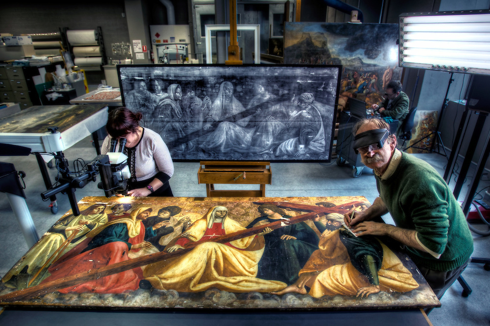 Conservation of 500 year old painting 'The Finding of the True Cross' at the NGV. Senior paintings conservator, John Payne at right, works with NGV intern Stephanie Limoges. Pic By Craig Sillitoe CSZ/The Sunday Age.14/9/2011 melbourne photographers, commercial photographers, industrial photographers, corporate photographer, architectural photographers, This photograph can be used for non commercial uses with attribution. Credit: Craig Sillitoe Photography / http://www.csillitoe.com<br />