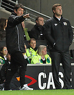 Picture by David Horn/Focus Images Ltd +44 7545 970036.25/09/2012.Mick Harford, Assistant Manager and Karl Robinson, Manager of Milton Keynes Dons look on  during the Capital One Cup match at stadium:mk, Milton Keynes.